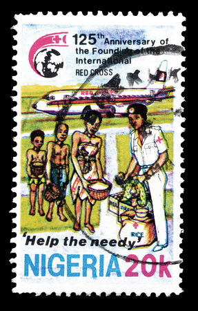 needy: Cancelled postage stamp printed by Nigeria, that shows Help to the needy, circa 1988.