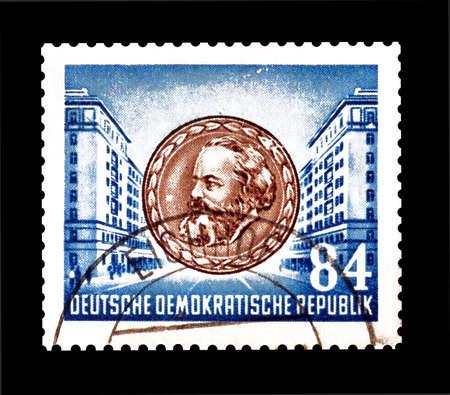 karl: Cancelled postage stamp printed by German Democratic Republic, that shows Karl Marx, circa 1953.