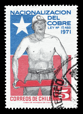 chilean flag: Cancelled postage stamp printed by Chile, that shows Miner and Chilean flag, circa 1971. Editorial