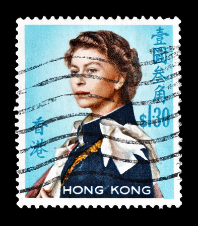 Cancelled postage stamp printed by Hong Kong, that shows Queen Elizabeth II, circa 1962.