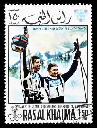 khaima: Cancelled postage stamp printed by Ras Al Khaima, that shows  Jean Claude Killy and Guy Perillat, circa 1968. Editorial