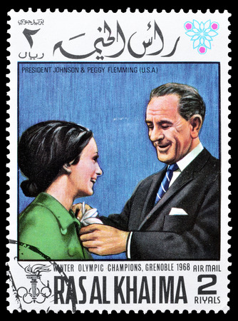 ras: Cancelled postage stamp printed by Ras Al Khaima, that shows  President Johnson and Peggy Flemming, circa 1968.