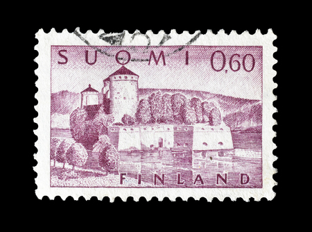 philately: Cancelled postage stamp printed by Finland, that shows Olavinlinna fortress, circa 1963.