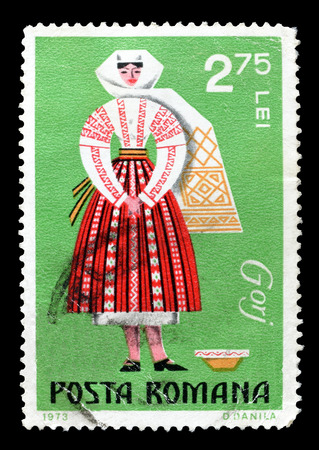 postage: Cancelled postage stamp printed by Romania, that shows Regional costume, circa 1973.