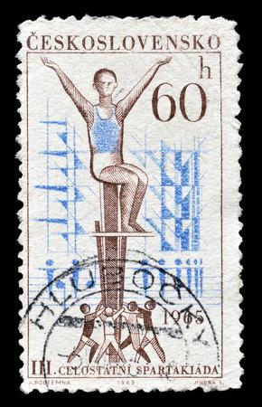 czechoslovakia: Cancelled postage stamp printed by Czechoslovakia, that shows Gymnasts, circa 1965.
