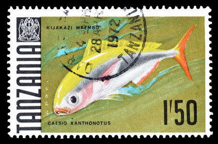 postage: Cancelled postage stamp printed by Tanzania, that shows Yellowback Fusilier, circa 1969.