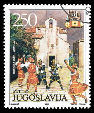 yugoslavia: Cancelled postage stamp printed by Yugoslavia, that shows Traditional dance in Korcula, circa 1987.