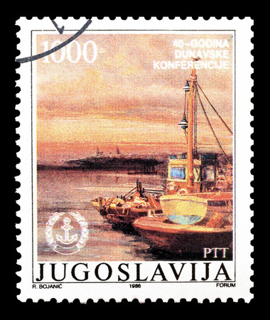 yugoslavia: Cancelled postage stamp printed by Yugoslavia, that shows Harbor at Danube, circa 1988.