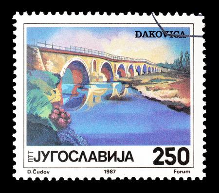 yugoslavia: Cancelled postage stamp printed by Yugoslavia, that shows Bridge in Djakovica, circa 1987. Editorial