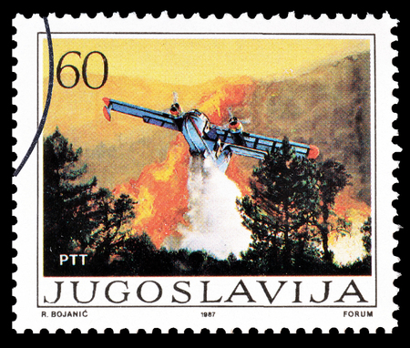 Cancelled postage stamp printed by Yugoslavia, that shows Plane putting out fire , circa 1987.
