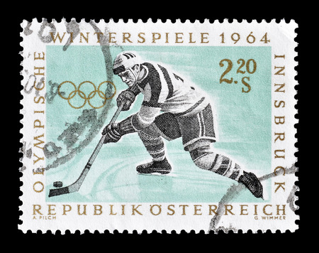 Cancelled postage stamp printed by Austria, that shows Hockey, circa 1964.