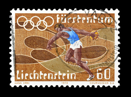 Cancelled postage stamp printed by Liechtenstein, that shows Discus throwing, circa 1972. Editorial