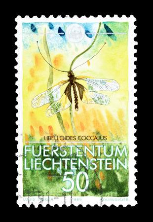 sulphur: Cancelled postage stamp printed by Liechtenstein, that shows Owly sulphur, circa 1989.
