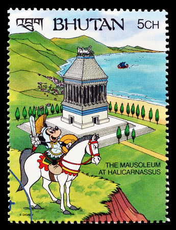 postage: Cancelled postage stamp printed by Bhutan, that shows Mickey Mouse visiting Mausoleum at Halicarnassuss, circa 1991. Editorial