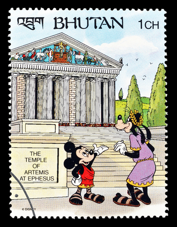 postage: Cancelled postage stamp printed by Bhutan, that shows Mickey Mouse and Goofy visiting Temple of Artemis, circa 1991. Editorial