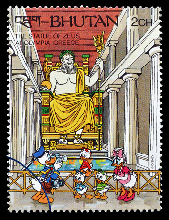 postage: Cancelled postage stamp printed by Bhutan, that shows Donald Duck,Daisy and Nephews, visiting The statue of Zeus, circa 1991. Editorial