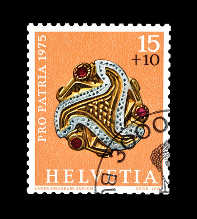 Cancelled postage stamp printed by Switzerland, that shows Antique jewelry, circa 1975.