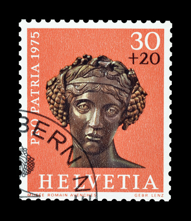 Cancelled postage stamp printed by Switzerland, that shows Head of a bronze statue of Bacchus, circa 1975.