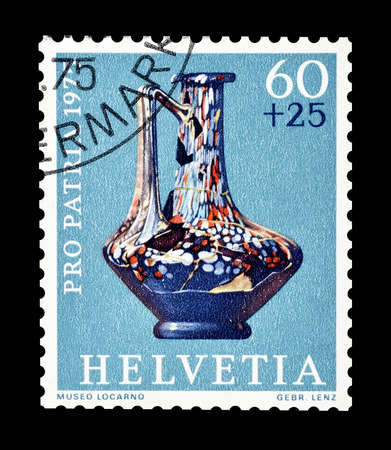 Cancelled postage stamp printed by Switzerland, that shows Henkel glass jar, circa 1975.
