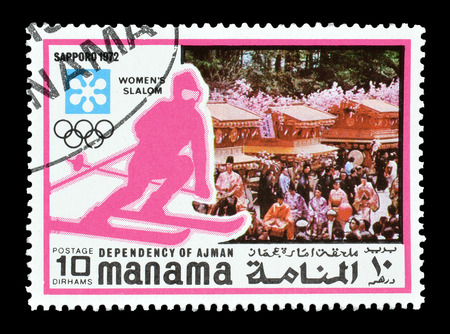 Cancelled postage stamp printed by Manama, that shows Slalom, circa 1971. Editorial