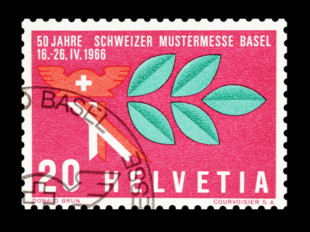 old mercury: Cancelled postage stamp printed by Switzerland, that shows Mercury hat and laurel branch, circa 1966.