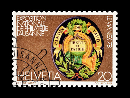 Cancelled postage stamp printed by Switzerland, that shows Shield from Waadtland, circa 1978. Editorial
