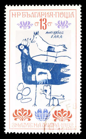 philately: Cancelled postage stamp printed by Bulgaria, that shows Children drawing, circa 1982. Editorial