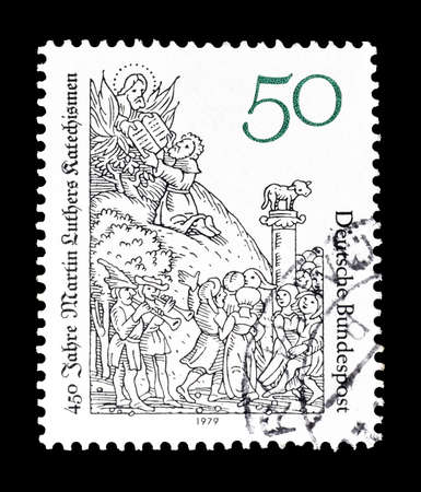 catechism: Cancelled postage stamp printed by Germany, that shows Martin Luthers catechism, circa 1979. Editorial