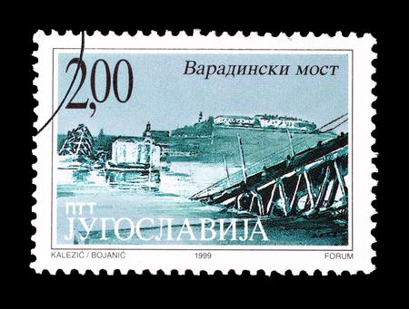 yugoslavia: Cancelled postage stamp printed by Yugoslavia, that shows Bombarding of Varadinski bridge, circa 1999.