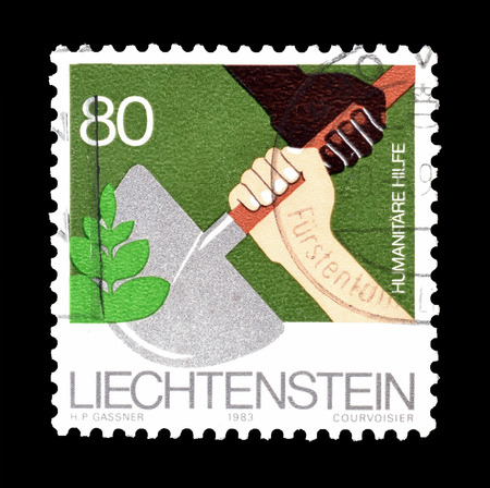 Cancelled postage stamp printed by Liechtenstein, that shows Humanitarian aid, circa 1983. Editorial
