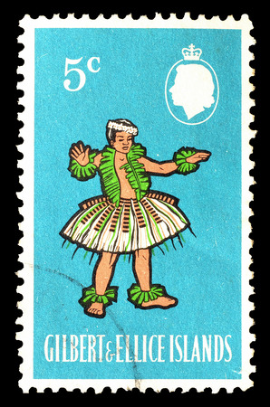 gilbert: Cancelled postage stamp printed by Gilbert and Ellice Islands, that shows Kosu Dance, circa 1965.