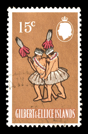 gilbert: Cancelled postage stamp printed by Gilbert and Ellice Islands, that shows Taua Dance, circa 1965.