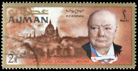 Cancelled postage stamp printed by Ajman, that shows Winston Churchill and London, circa 1966.