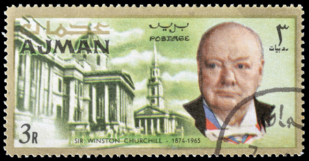 churchill: Cancelled postage stamp printed by Ajman, that shows Winston Churchill and National library, circa 1966.