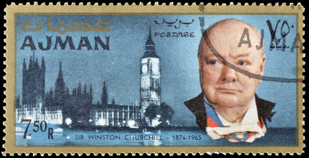 churchill: Cancelled postage stamp printed by Ajman, that shows Winston Churchill and Parliament, circa 1966. Editorial