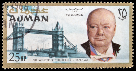 churchill: Cancelled postage stamp printed by Ajman, that shows Winston Churchill and Tower bridge, circa 1966. Editorial