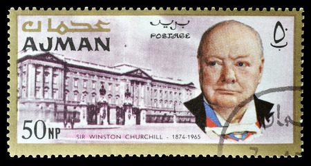 churchill: Cancelled postage stamp printed by Ajman, that shows Winston Churchill and Buckingham palace, circa 1966. Editorial