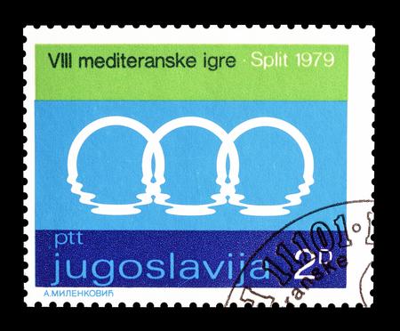 Cancelled postage stamp printed by Yugoslavia, that shows Mediterranean games logo, circa 1979.