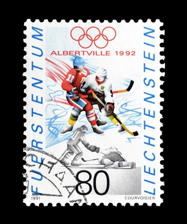 Cancelled postage stamp printed by Liechtenstein, that shows Hockey, circa 1991.