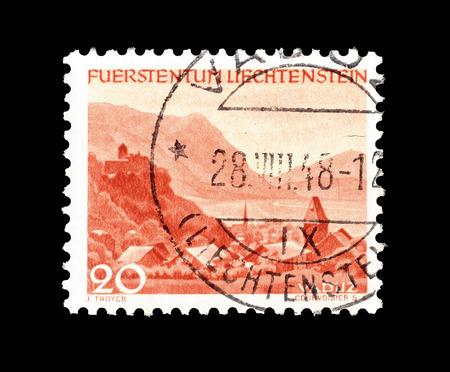 Cancelled postage stamp printed by Liechtenstein, that shows Vaduz, circa 1944.
