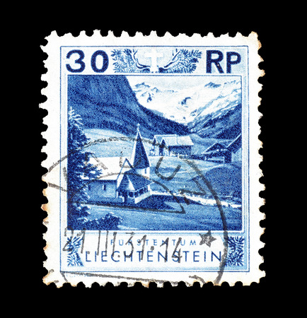 Cancelled postage stamp printed by Liechtenstein, that shows Chapel, circa 1930. Editorial