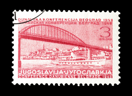 philately: Cancelled postage stamp printed by Yugoslavia, that shows Bridge and ship, circa 1948.