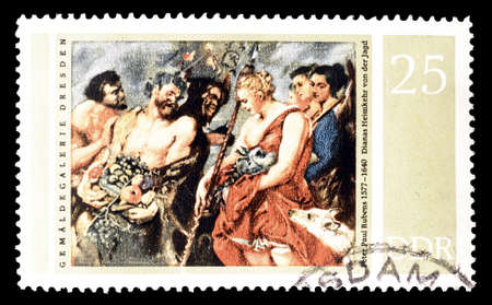 philately: Cancelled postage stamp printed by East Germany, that shows  Painting by Rubens, circa 1977. Editorial