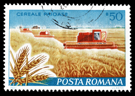 postage: Cancelled postage stamp printed by Romania, that shows Wheat farm and combine harvester. Editorial