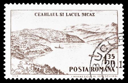 1964 年頃の Ceahlau 山地と湖 Bicaz を示すルーマニアによって印刷された切手をキャンセルします。