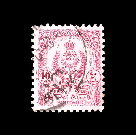 1955 年頃の紋章を示すリビアによって印刷された切手をキャンセルします。 報道画像