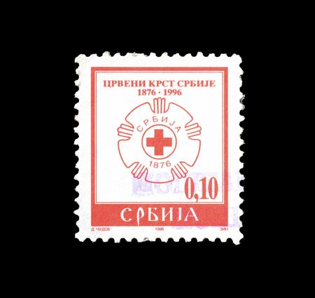 1996年頃、赤十字のエンブレムを示すセルビアが印刷した郵便切手の取り消し。