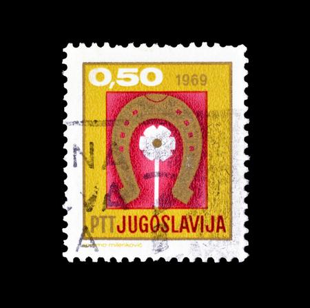 ホースシューと 1968 年頃の花を示すユーゴスラビアによって印刷された切手をキャンセルします。