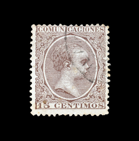 Cancelled postage stamp printed by Spain, that shows King Alfonso, circa 1889. Editorial