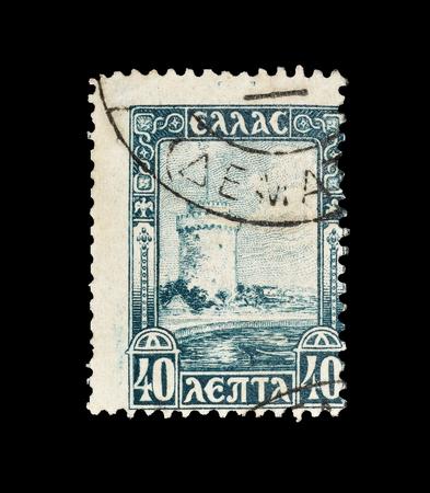 ギリシャが印刷した郵便切手の取り消しは、テッサロニキのホワイトタワー(1927年頃)を示しています。